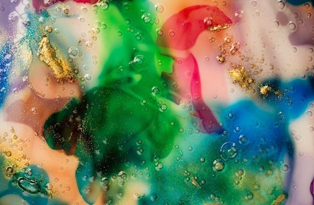 Абстрактный красочный акварельный фон. жидкое стекло с пузырьками и золотой пылью.