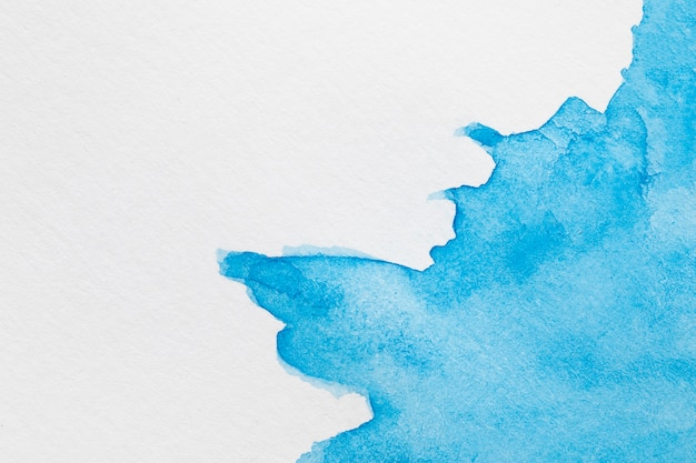 Abstract coloured ink waves on white surface