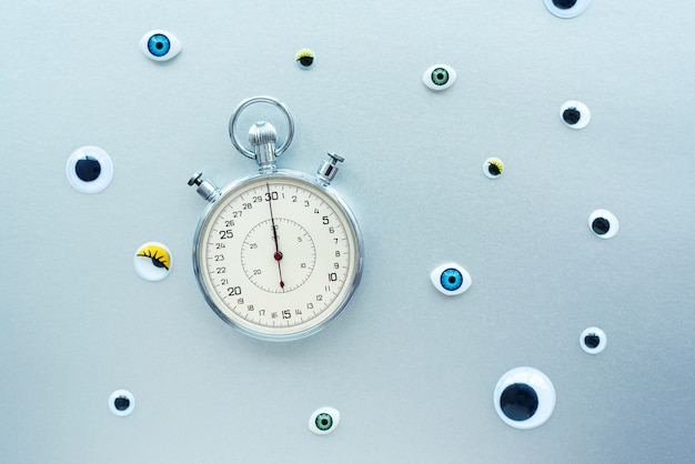 Abstract composition with stopwatch and eyes. create conceptual with time, deadlines, stress, aging