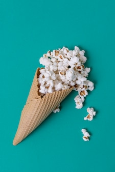 Abstract concept of ice cream cone and salted popcorn