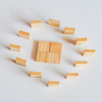 Abstract concept of wooden cubes toy stack to tower.