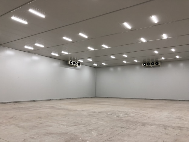 Abstract concrete interior with empty wall. gallery concept.