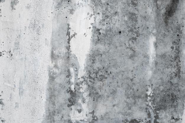 抽象的なコンクリート壁の背景、古い灰色の石のグランジテクスチャ。アーキテクチャの大まかな背景。セメント、白い漆喰の壁紙。建物の都市モノクロ塗装面。