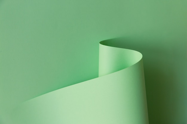 Abstract creative design of light green curve-shaped paper