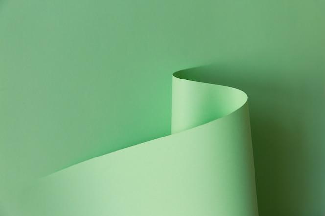 밝은 녹색 곡선 모양의 종이의 추상 크리 에이 티브 디자인