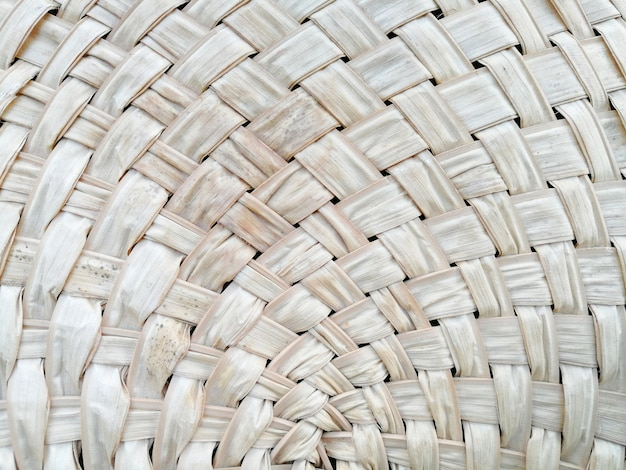 Abstract criss cross dried palm leaf hand fan background