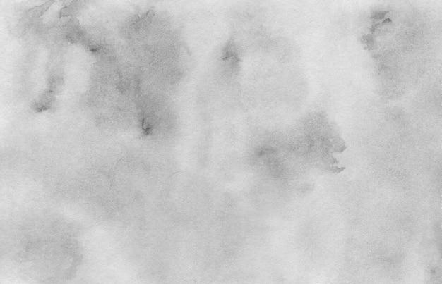 抽象的なダークグレーとライトグレーの水彩背景ウォッシュテクニック