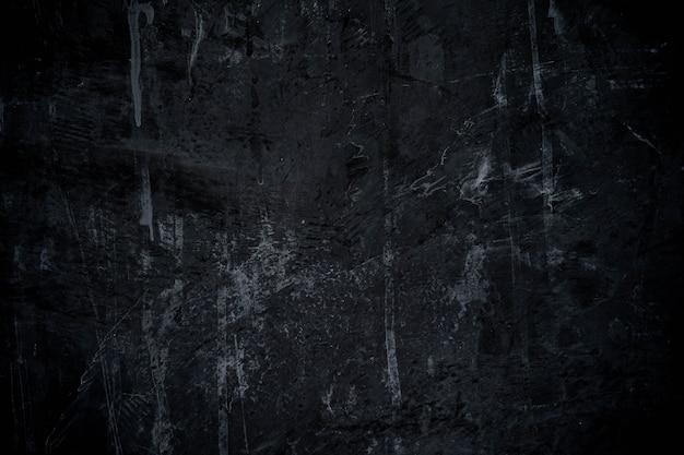 ブラシとセメントの壁テクスチャ背景と抽象的な暗い黒の塗料
