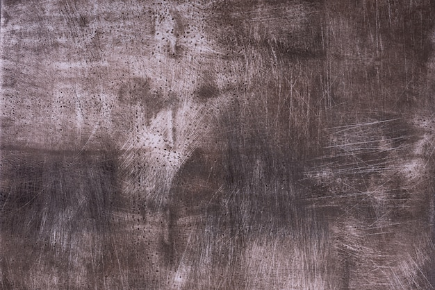 Abstract dark brown grunge texture with scratches