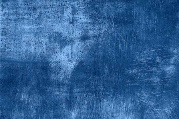Abstract dark monochrome grunge texture with scratches, copy space. trendy blue and calm color. concrete texture, stone background