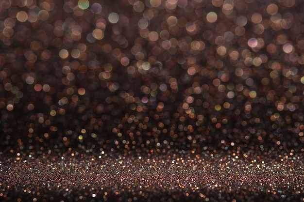 Abstract dark orange brown sparkling glitter wall and floor perspective background studio with blur bokeh