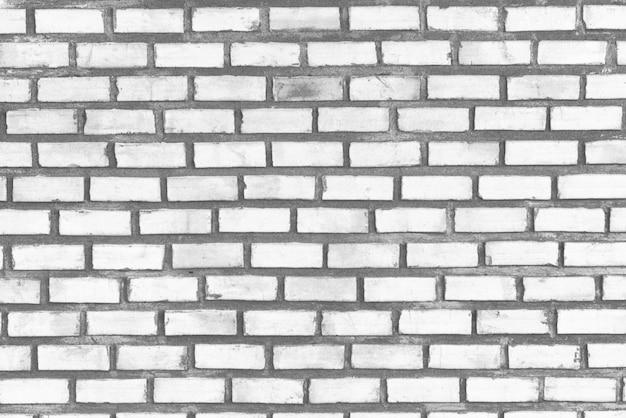Abstract dark white gray brick wall texture background