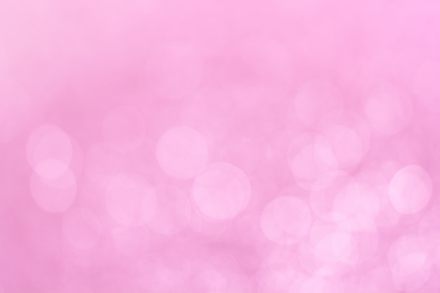 Abstract defocused lights pink tone lights background.