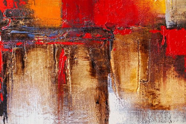 Абстрактная деталь акриловых красок на холсте. рельефный художественный фон в золоте, красном, черном и серебряном цвете