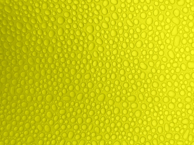 Abstract drops of water on a yellow background. raindrops.