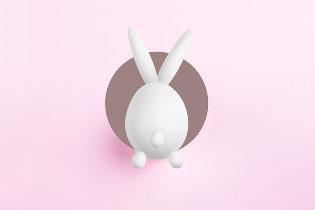 Abstract easter bunny jumps in the hole, happy easter concept