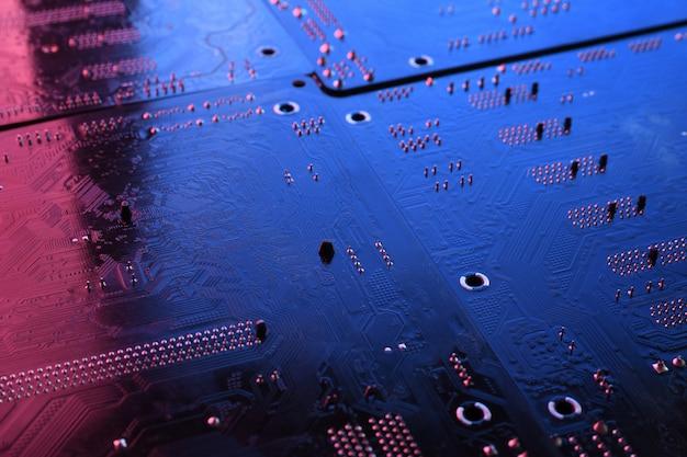 抽象的な電子回路基板、コンピューターのマザーボードのラインとコンポーネントの背景