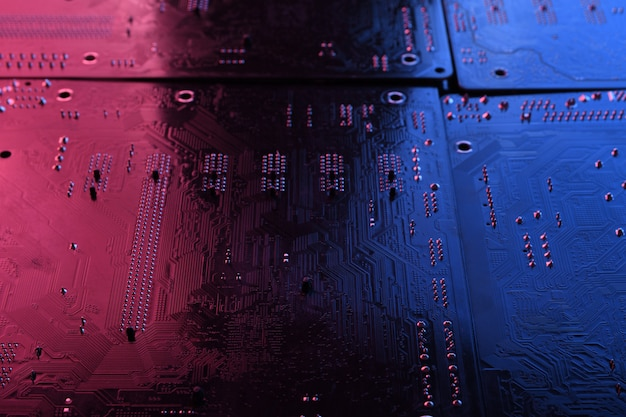 Abstract electronic circuit board, computer motherboard lines and components, beautiful red and blue color
