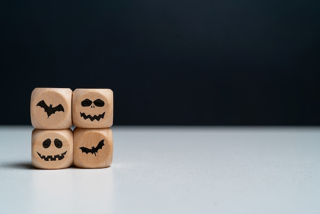 Abstract emotions with bats on wooden cubes with copy space halloween holiday