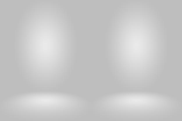 黒の無地のビネット照明スタジオの壁と床の背景との抽象的な空のダークホワイトグレーのグラデーションは、背景としてよく使用されます。