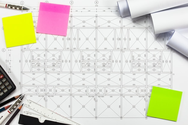 Abstract engineering drawings background with blank for your word. construction plan tools with empty space on desk.