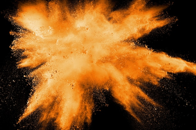 Abstract explosion of orange dust on white background. freeze motion of orange dust splashing.