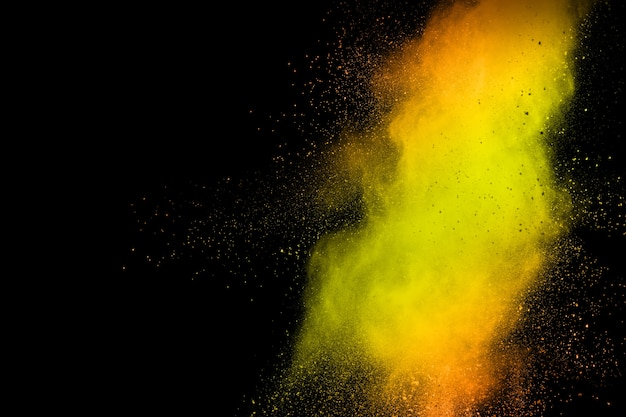 Abstract explosion of orange dust on white background.