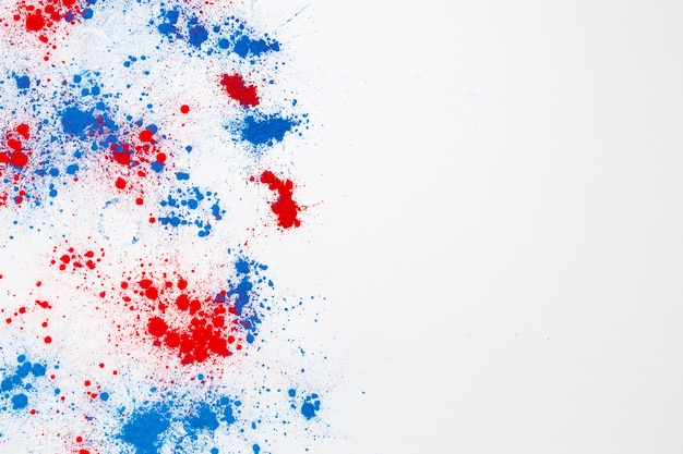 Abstract explosion of red and blue holi color powder with copyspace on the right