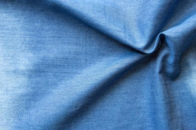 Абстрактная текстура ткани синих джинсов джинсовая комбинированная фон