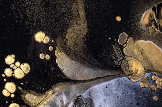 추상 유체 예술 배경 검정과 황금 색상. 그라데이션 캔버스에 액체 아크릴 페인팅. 패턴으로 수채화 배경입니다.