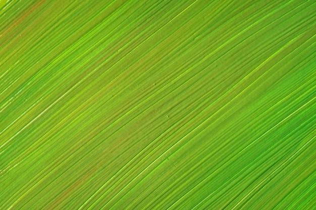 抽象的な流体アートの背景の明るい緑色。液体大理石。オリーブのグラデーションでキャンバスにアクリル画。縞模様の水彩画の背景。石の大理石の壁紙。