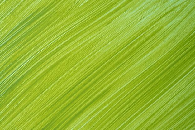 抽象的な流体アートの背景の明るい緑色。液体大理石。オリーブのグラデーションでキャンバスにアクリル画。
