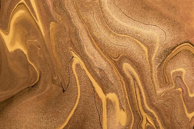 抽象的な流体アートの背景の濃い金色と銅色。液体大理石
