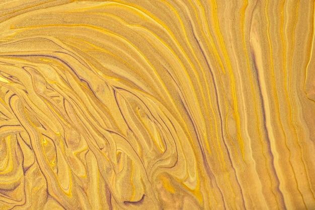 抽象的な流体アートの背景の濃い金色と黄色。液体大理石。黄土色のグラデーションのアクリル画。