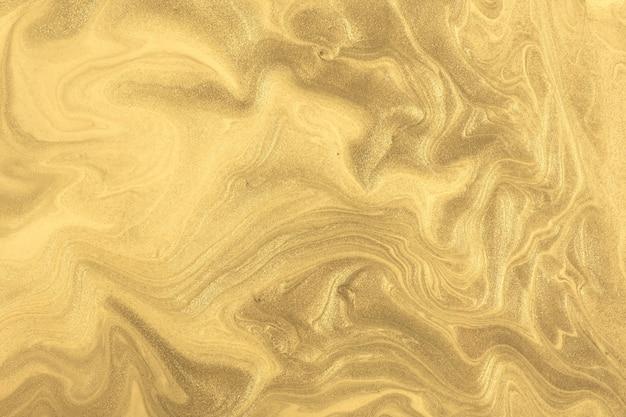 抽象的な流体アートの背景の濃い金色。液体大理石