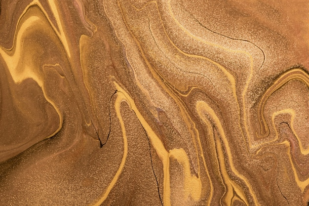 Abstract fluid art background dark golden and copper colors. liquid marble