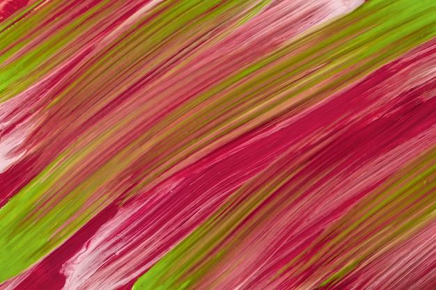 抽象的な流体アートの背景濃い紫と緑の色。液体大理石。赤いグラデーションのキャンバスにアクリル画。縞模様の水彩画の背景。