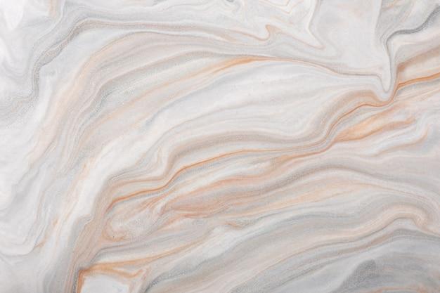 Абстрактное искусство жидкого фона серого и белого цветов. жидкий мрамор. акриловая картина с бежевым градиентом.