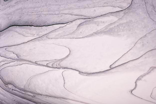 추상 유체 아트 배경 회색과 흰색 색상. 액체 돌 대리석. 그라데이션으로 아크릴 페인팅.