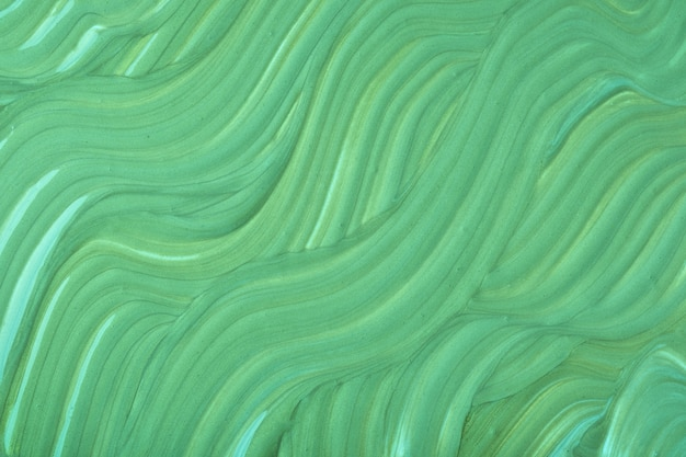Abstract fluid art background green colors acrylic painting with olive gradient with wavy pattern