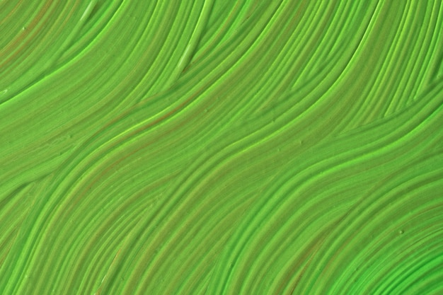 Abstract fluid art background green colors. liquid marble. acrylic painting on canvas with olive gradient. watercolor backdrop with wavy pattern.