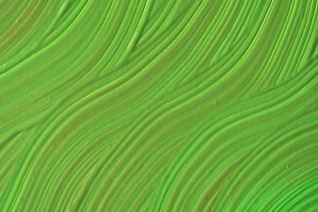 抽象的な流体アートの背景の緑色。液体大理石。オリーブのグラデーションでキャンバスにアクリル画。波状のパターンの水彩画の背景。