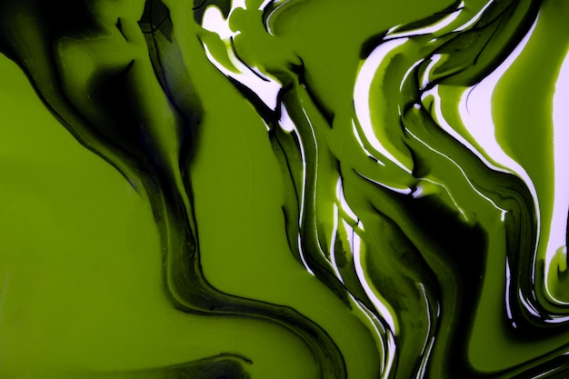 Abstract fluid art background green, white and black colors. liquid marble. acrylic painting on canvas with olive gradient and splash. alcohol ink backdrop with waves pattern.