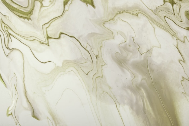 Abstract fluid art background light green and beige colors. liquid marble. acrylic painting on canvas with olive gradient and splash
