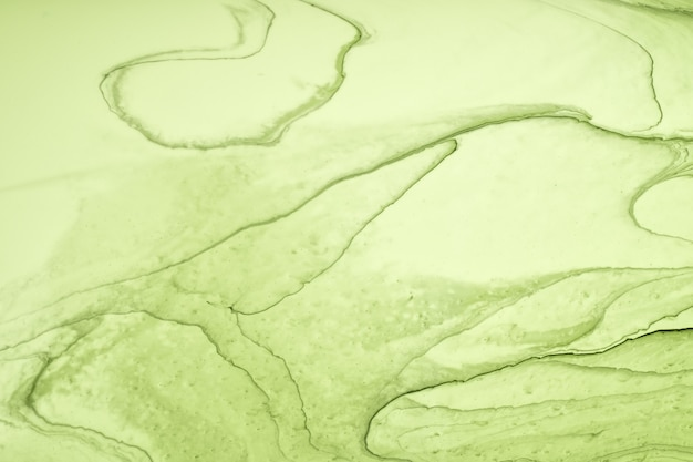 Abstract fluid art background light green colors. liquid marble