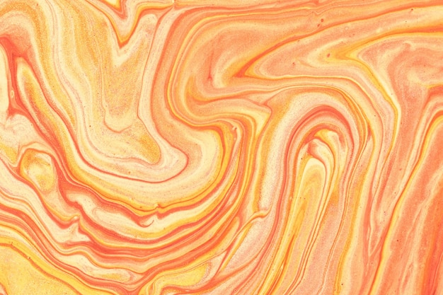 Abstract fluid art background light orange and golden glitter colors. liquid marble. acrylic painting on canvas with coral gradient. watercolor backdrop with red wavy pattern. stone section.