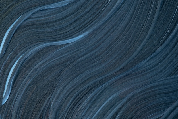 Abstract fluid art background navy blue colors. liquid marble. acrylic painting on canvas with dark gray gradient. watercolor backdrop with wavy pattern.