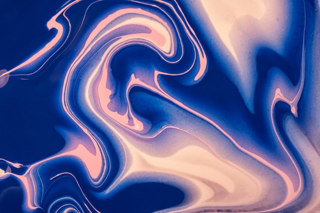 Abstract fluid art background navy blue and pink colors. liquid marble
