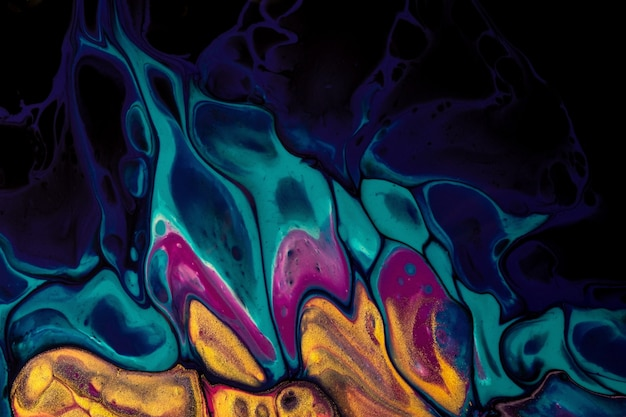 Abstract fluid art on black background dark purple and blue colors