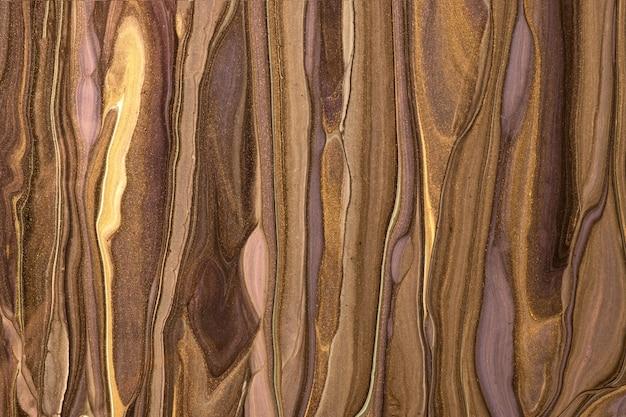 추상 유체 예술 어두운 갈색과 황금색. 액체 대리석. 청동 그라데이션으로 아크릴 페인팅.